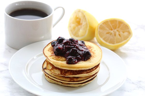 Easy low carb lemon ricotta blender pancakes with mixed berry sauce