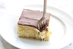 Ooey gooey low carb Boston Cream Pie Poke Cake recipe