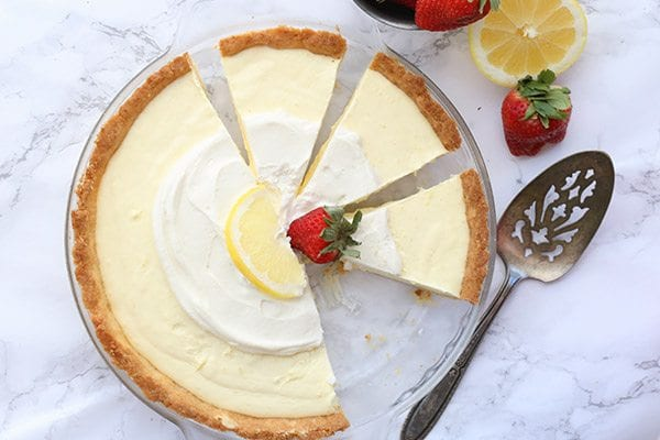 Top down photo of keto lemon pie cut into slices in a pie pan
