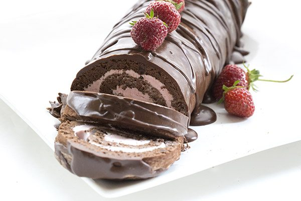 The best low carb chocolate cake roll, filled with strawberry cheesecake!