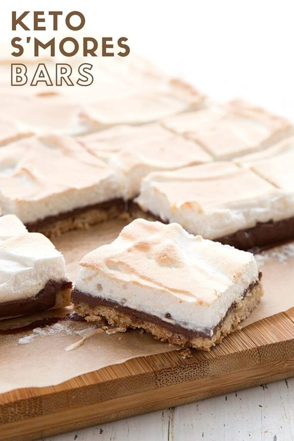 Titled image of keto s'mores bars on a cutting board, with one bar in front