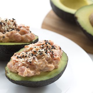 Easy low carb spicy tuna stuffed avocados.