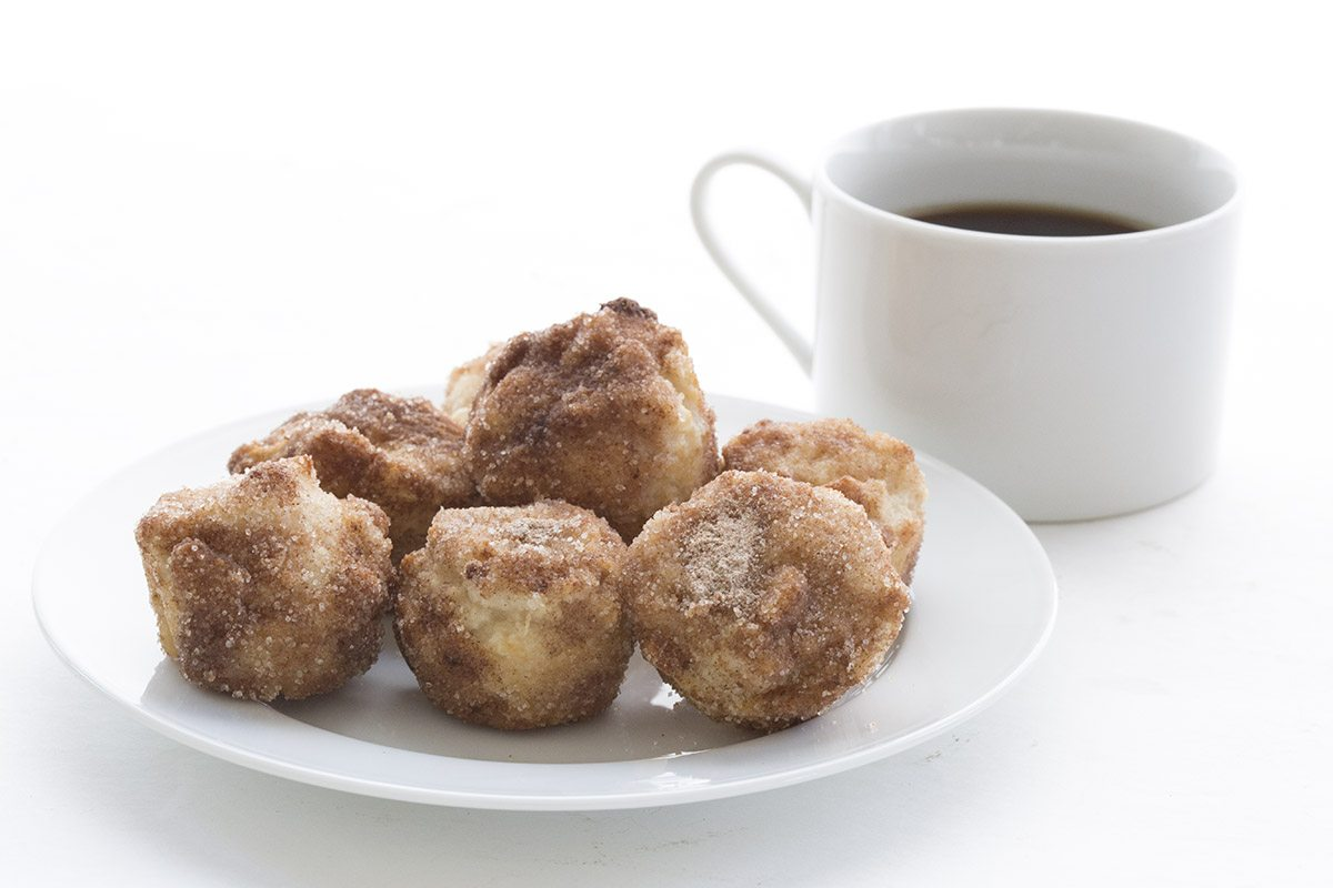 "These little donut bites are dipped in butter and rolled in cinnamon ""sugar"". Low carb, grain-free and sugar-free!"
