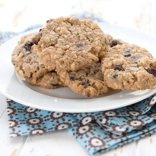 Keto oatmeal cookies on a plate over a blue patterned napkin.