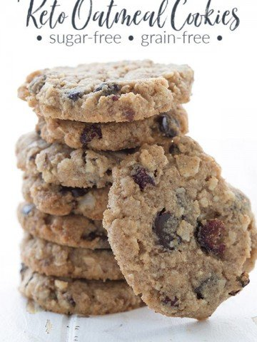 Keto oatmeal cookies in a stack on a white table.