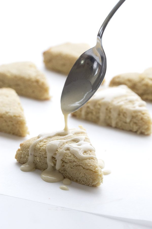 Drizzling sugar-free glaze over delicious low carb Eggnog Scones