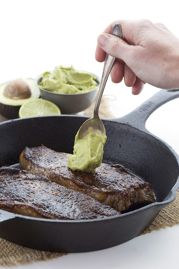 Easy pan-fried steak with avocado crema. A deliciously healthy low carb meal.