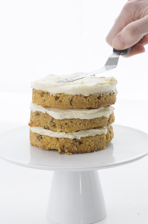 Sugar-free cream cheese frosting on a triple layer low carb carrot cake.