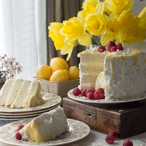 Heavenly low carb coconut layer cake with lemon curd and whipped cream frosting.