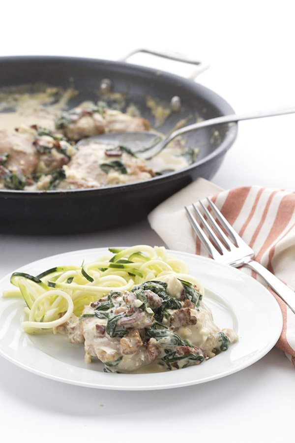 Love this easy low carb skillet chicken recipe with a creamy bacon spinach sauce.