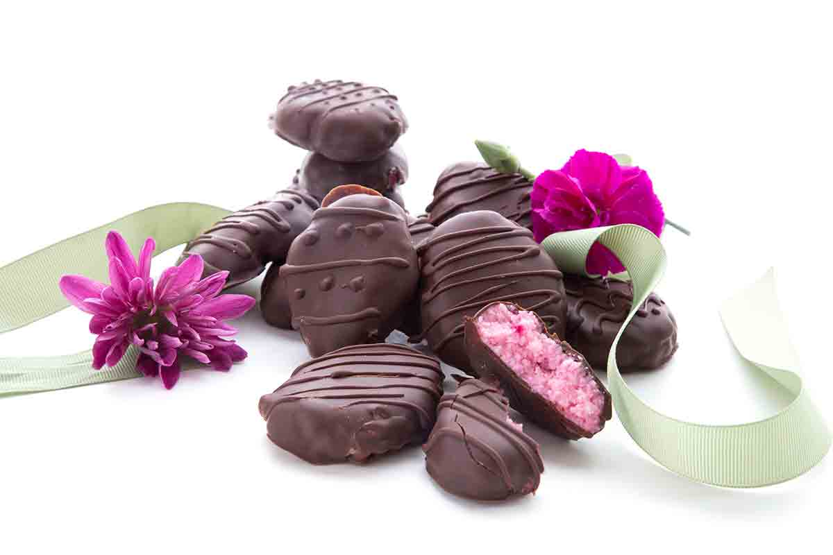 Low Carb Sugar-Free Easter Eggs in a pile with flowers and ribbon