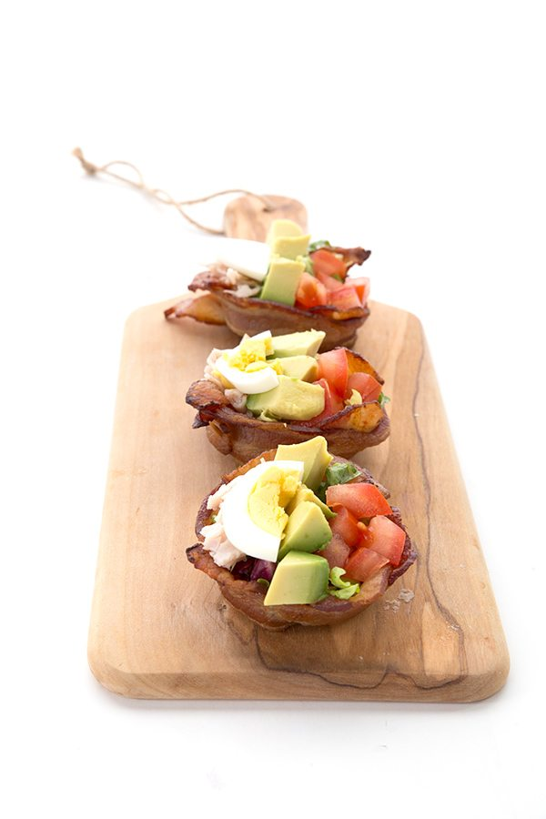 Bacon Cups filled with Cobb Salad on a wooden serving board