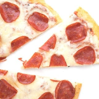 Top down photo of fathead pizza on a white background