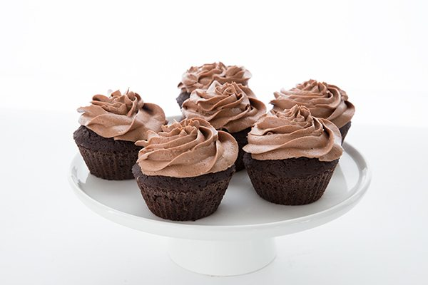 Low Carb Chocolate Hazelnut Cupcakes on a cake stand
