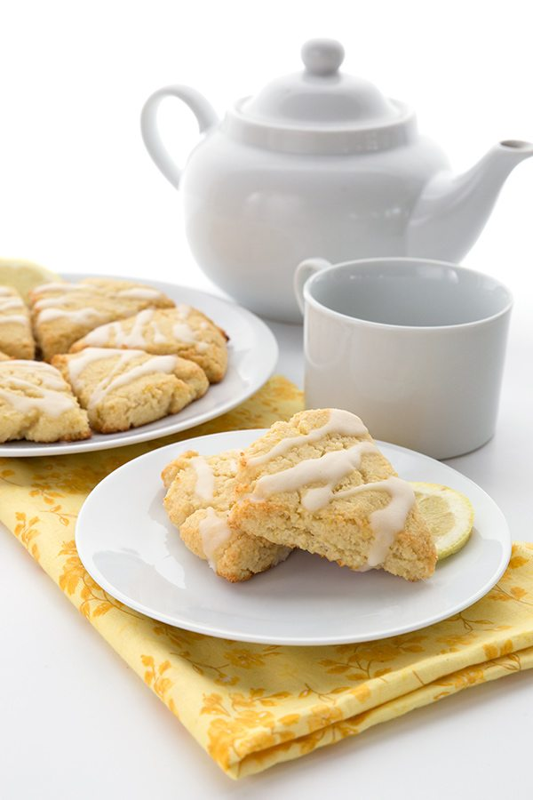 Sugar-free Lemon Ricotta Scones on a plate with a yellow napkin.