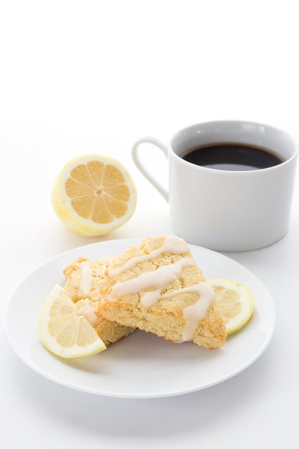 Keto Lemon Ricotta Scones on a white plate with coffee.