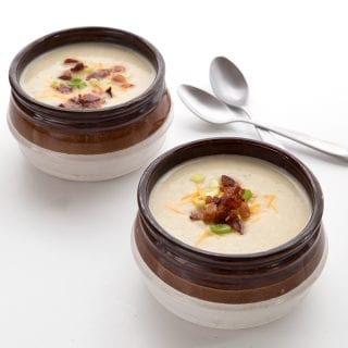 Delicious low carb loaded cauliflower soup in two brown bowls