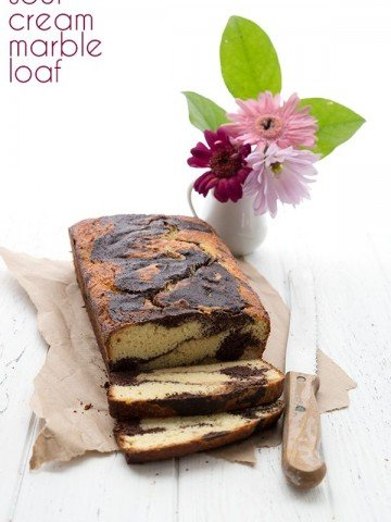 Low carb marble loaf cake cut into slices with flowers