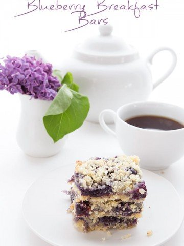 Low Carb Blueberry Crumble Bars in front of flowers and coffee
