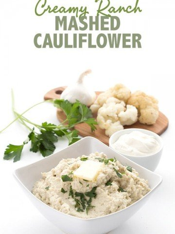 Creamy mashed cauliflower in a bowl with butter melting. Title photo