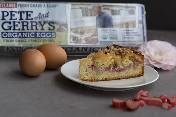 A slice of keto coffee cake with eggs in the background