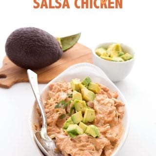 Instant pot salsa chicken sprinkled with avocado