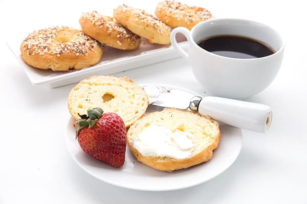 Keto bagels for breakfast! On a white platter with a cup of coffee