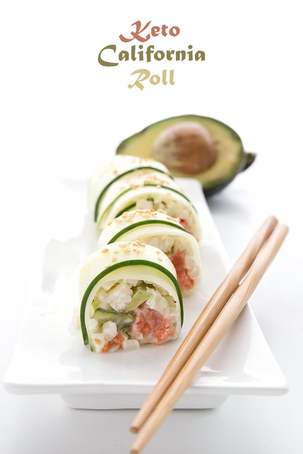 Keto Sushi wrapped in thinly sliced cucumber on a white platter