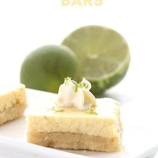 Sugar-free key lime bars with limes behind.
