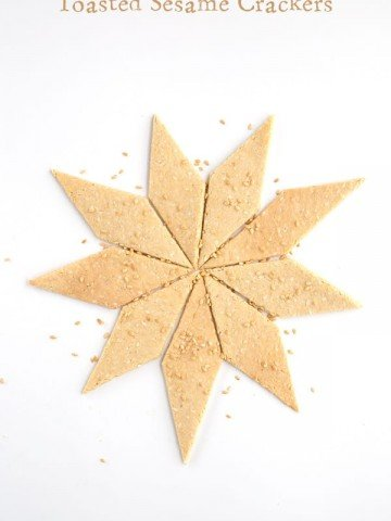 Keto Sesame Crackers in a star pattern with sesame seeds