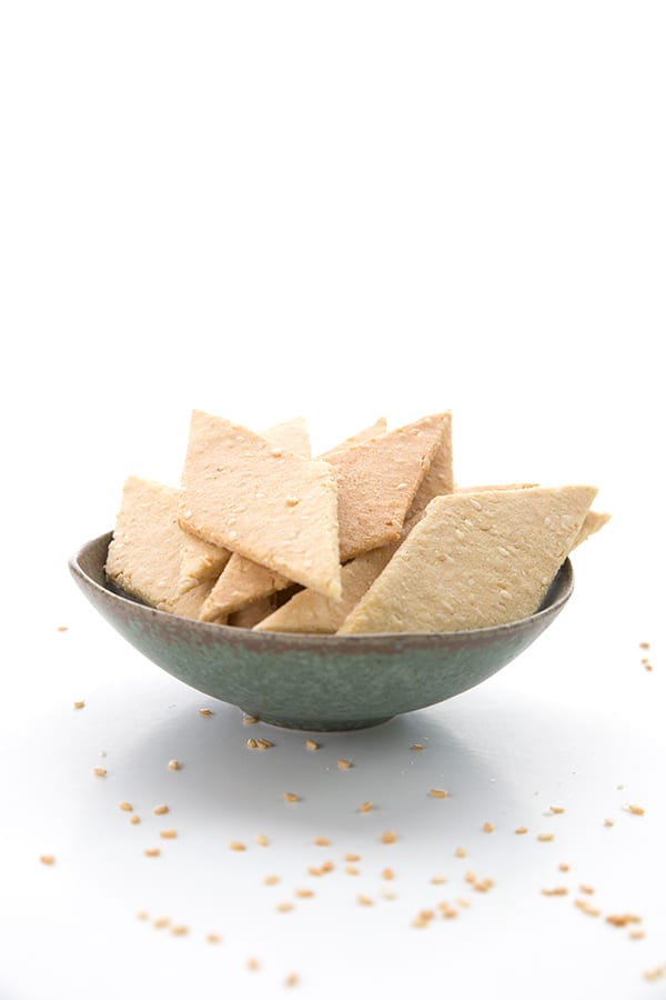 Keto toasted sesame crackers in a small bowl