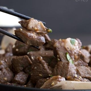 Easy Steak Bites being picked up with chopsticks