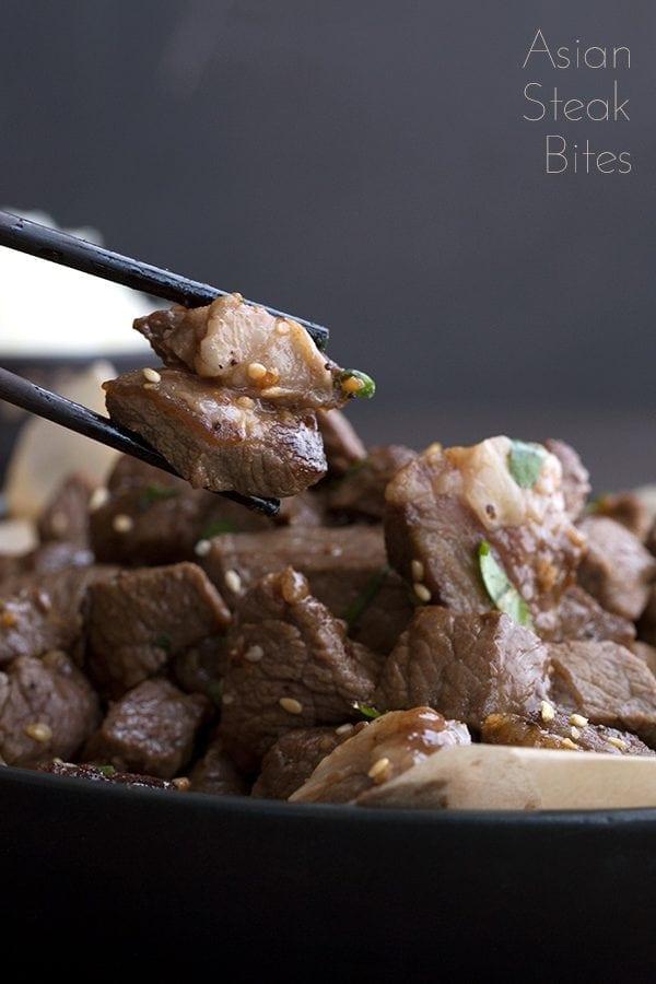 Easy Steak Bites being picked up with chopsticks