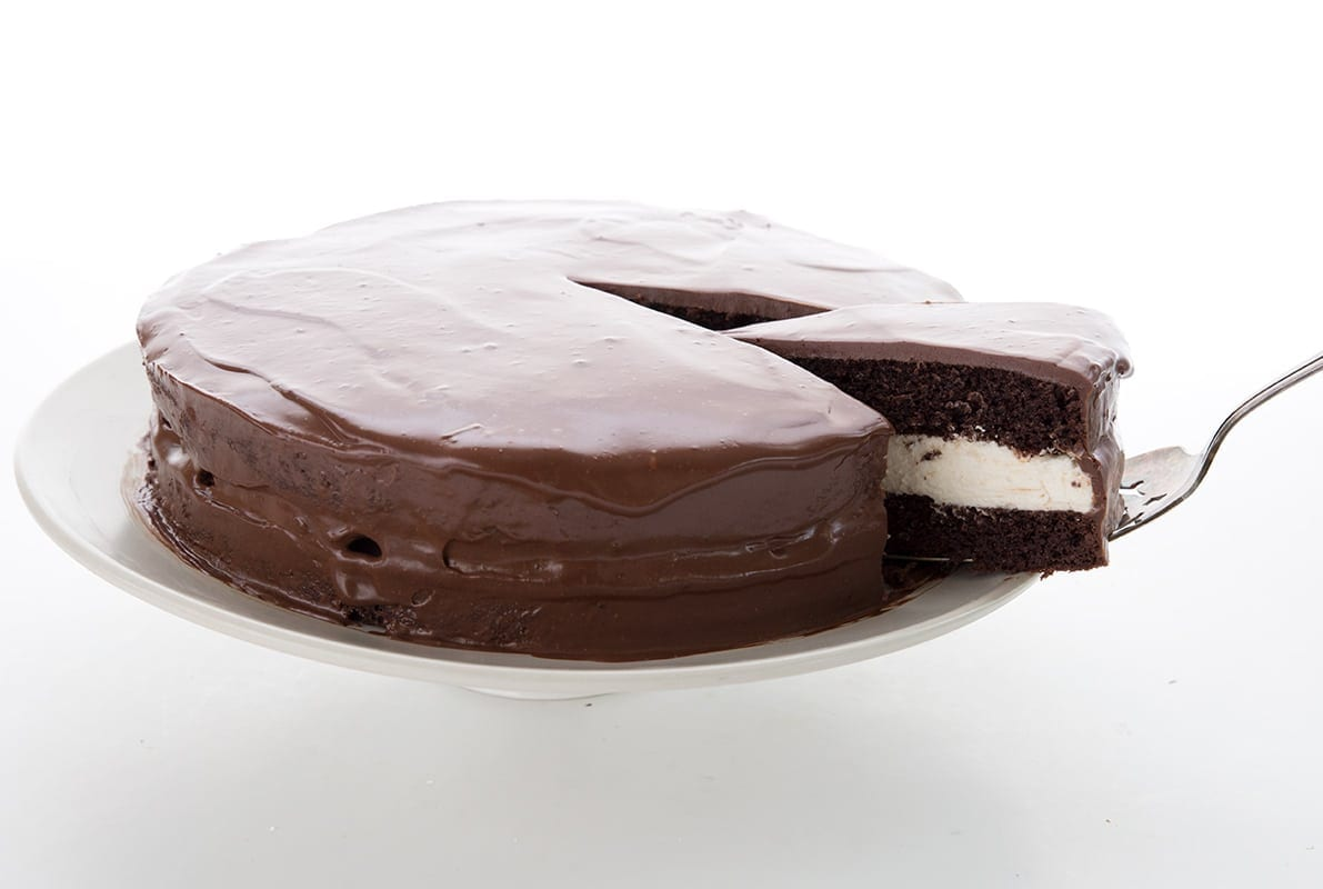 A slice being taken out of the low carb Ding Dong cake