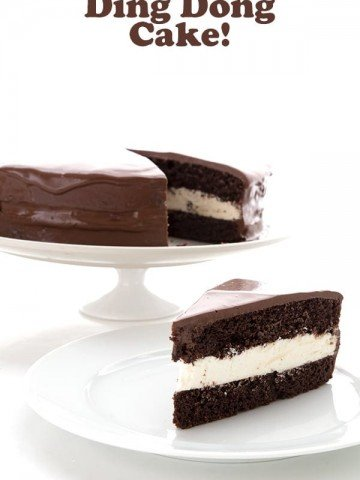 Low Carb Ding Dong Cake slice on a white plate with the whole cake in the background