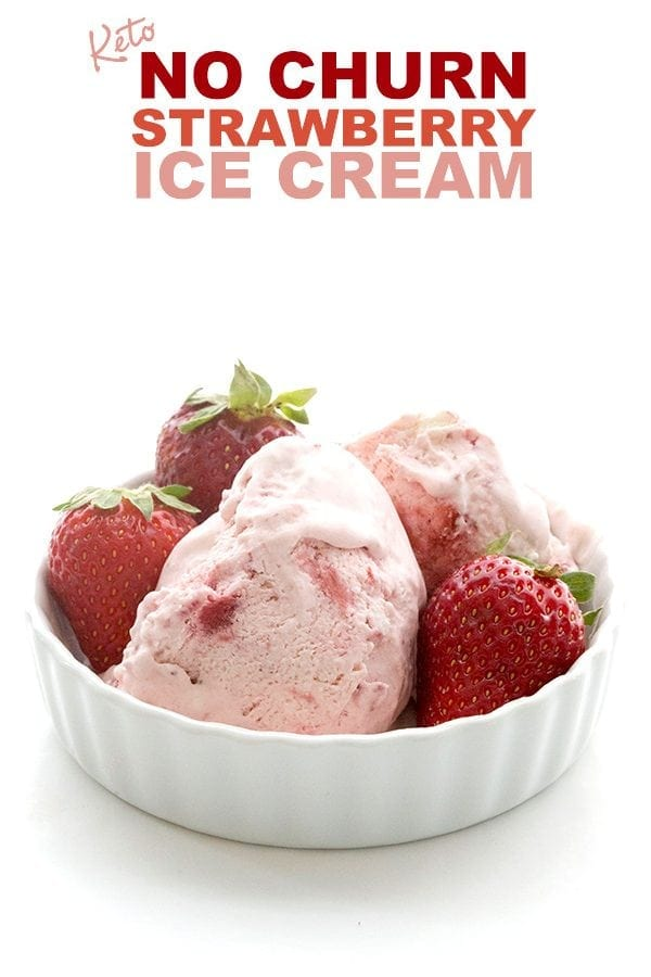 Easy Keto Strawberry Ice Cream in a white dish with strawberries around it.