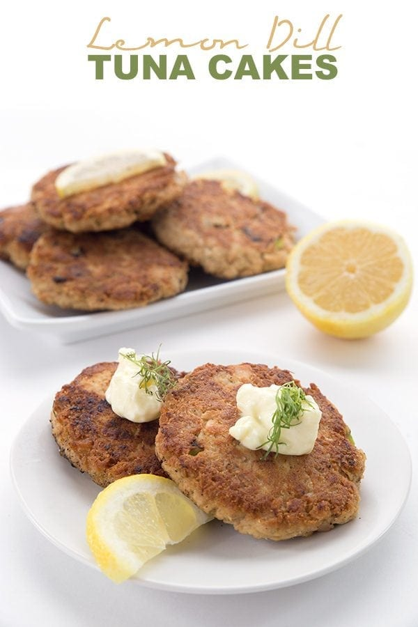 Keto Tuna Patties on a white plate with lemon slices, mayonnaise, and dill