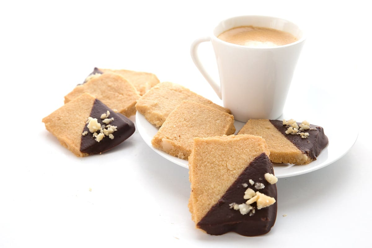 Low Carb Macadamia Shortbread cookies with a small espresso