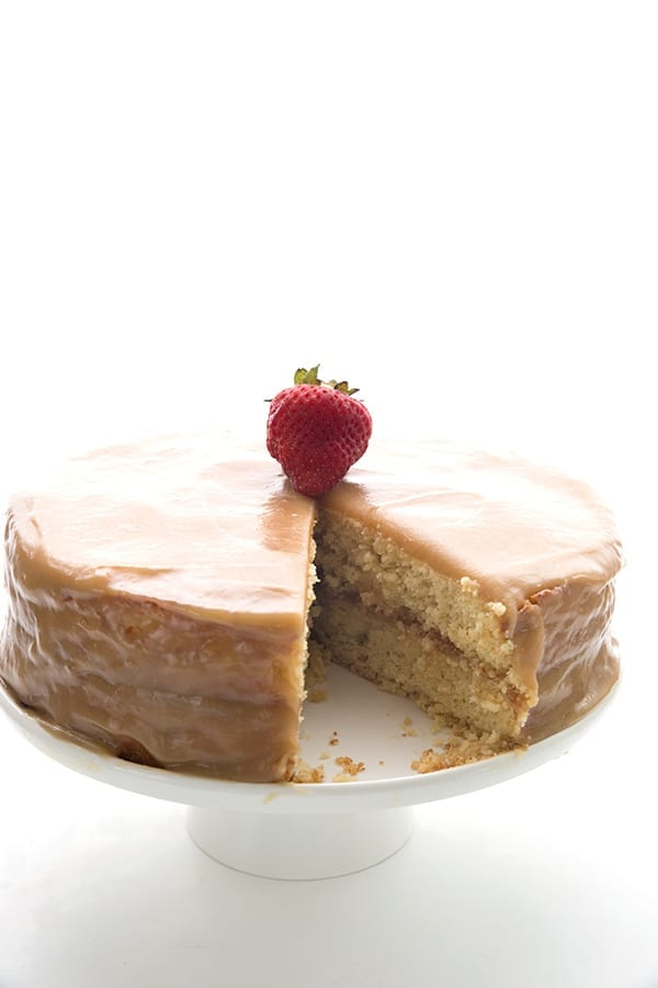 Caramel cake on a white cake stand