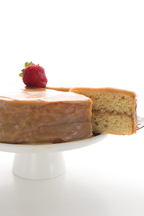A slice being cut out of Southern Caramel Cake