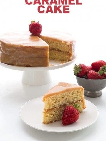 Sugar Free Caramel Cake slice on a white plate with a strawberry