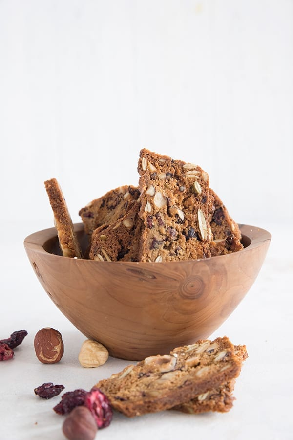 Keto cranberry hazelnut crisps in a wooden bowl