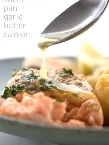 Easy salmon recipe with garlic butter being drizzled over