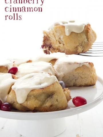 Keto Cranberry Cinnamon Rolls on a white cake platter.
