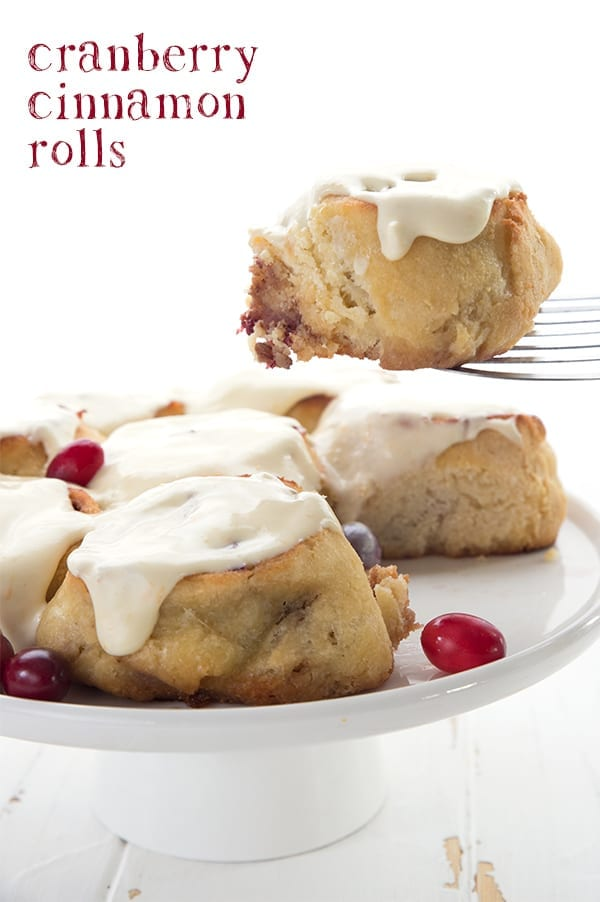 Keto Cranberry Cinnamon Rolls on a white cake platter.
