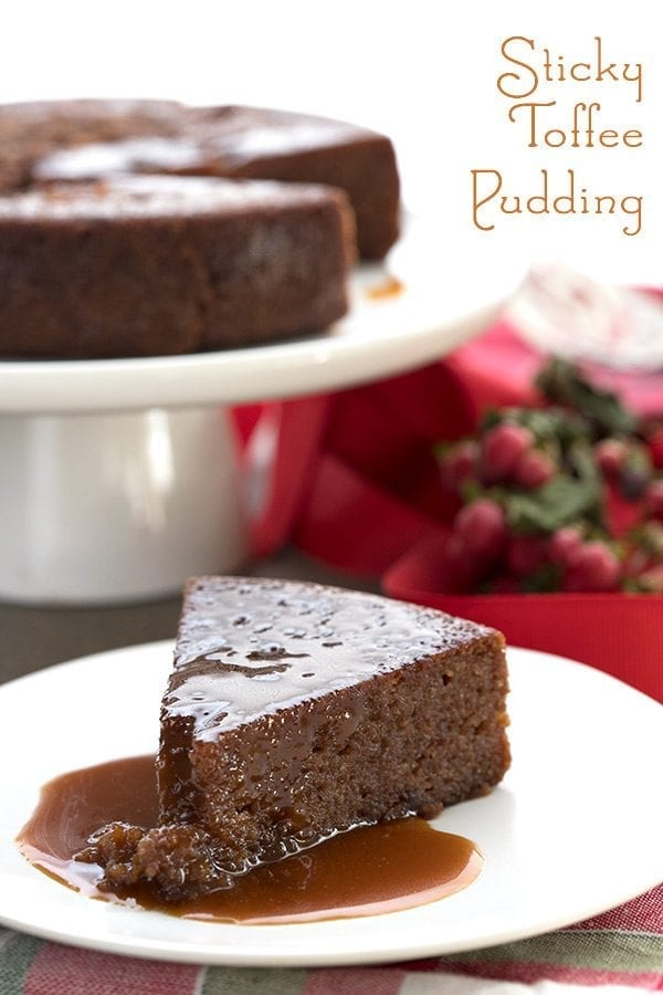 Keto Sticky Toffee Pudding on a white plate with holiday napkins