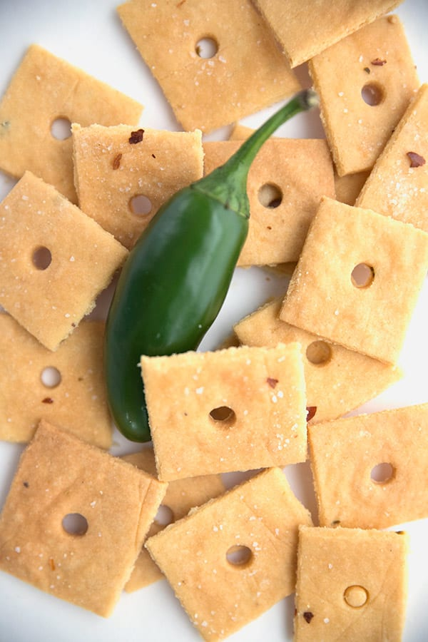 Cheese crackers in a pile with a jalapeño