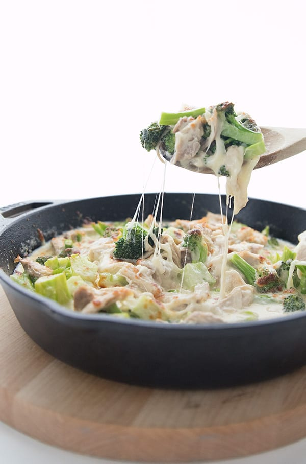 A scoopful of easy Chicken Broccoli Casserole on a wooden spoon
