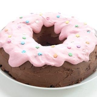 Keto Chocolate Donut Cake on a white cake stand