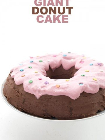 Keto chocolate bundt cake made to look like a chocolate donut with pink frosting